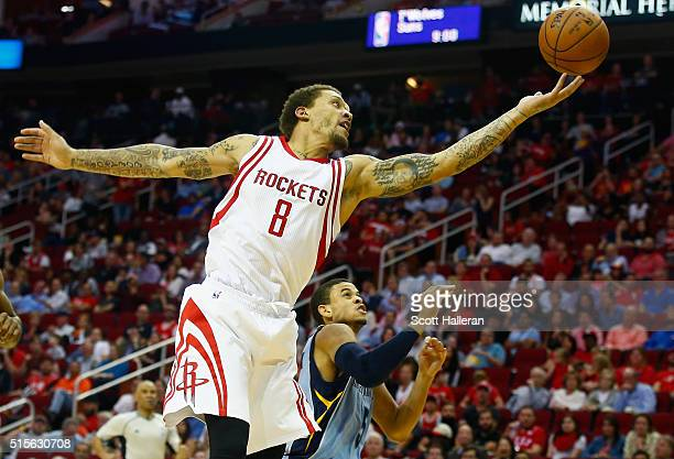 Michael Beasley of the Houston Rockets drives with the basketball against Ray McCallum of the Memphis Grizzlies during their game at the Toyota...