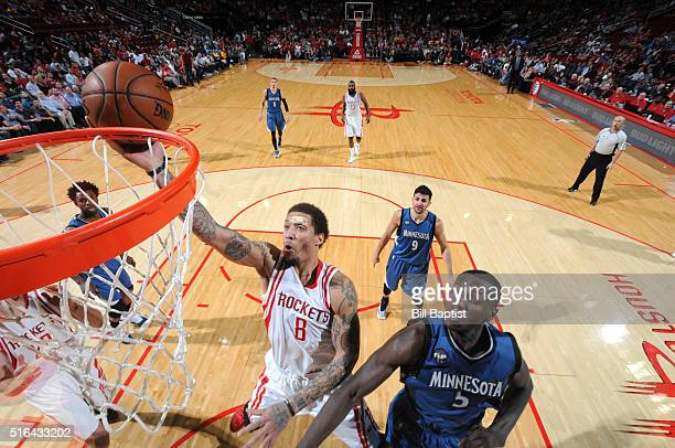 Michael Beasley of the Houston Rockets goes to the basket against the Minnesota Timberwolves on March 18 2016 at the Toyota Center in Houston Texas...