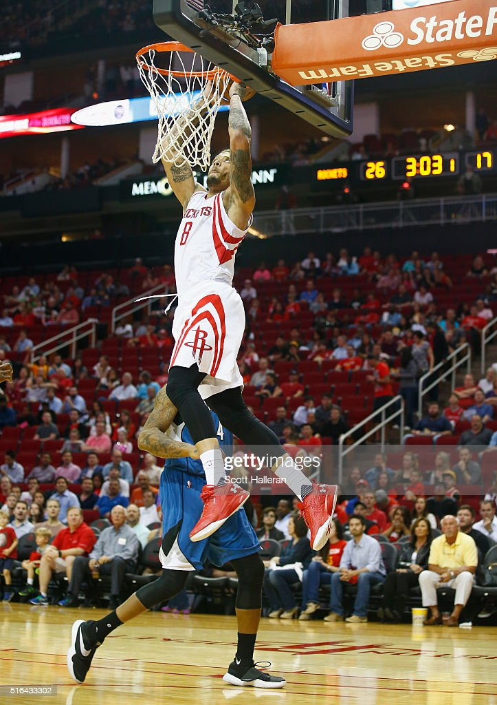 <a gi-track='captionPersonalityLinkClicked' href=/galleries/search?phrase=Michael+Beasley&family=editorial&specificpeople=4135134 ng-click='$event.stopPropagation()'>Michael Beasley</a> #8 of the Houston Rockets takes a shot over <a gi-track='captionPersonalityLinkClicked' href=/galleries/search?phrase=Greg+Smith+-+Basketballer+-+Center&family=editorial&specificpeople=11490234 ng-click='$event.stopPropagation()'>Greg Smith</a> #4 of the Minnesota Timberwolves at the Toyota Center on March 18, 2016 in Houston, Texas.