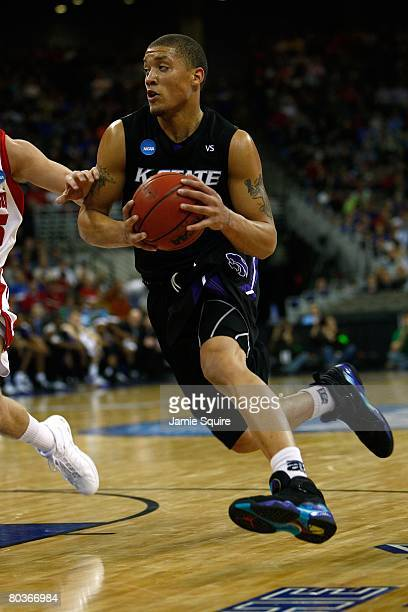 Michael Beasley of the Kansas State Wildcats drives against the Wisconsin Badgers during the Midwest Region second round of the 2008 NCAA Men's...