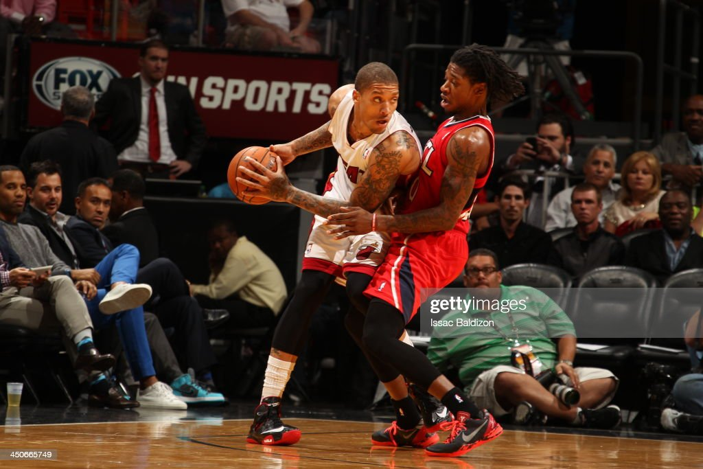 <a gi-track='captionPersonalityLinkClicked' href=/galleries/search?phrase=Michael+Beasley&family=editorial&specificpeople=4135134 ng-click='$event.stopPropagation()'>Michael Beasley</a> #8 of the Miami Heat controls the ball against <a gi-track='captionPersonalityLinkClicked' href=/galleries/search?phrase=Cartier+Martin&family=editorial&specificpeople=834581 ng-click='$event.stopPropagation()'>Cartier Martin</a> #20 of the Atlanta Hawks on November 19, 2013 at American Airlines Arena in Miami, Florida.