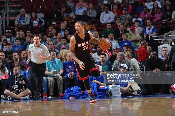 Michael Beasley of the Miami Heat dribbles the ball against the Philadelphia 76ers at Wells Fargo Center on April 15 2015 in Philadelphia...