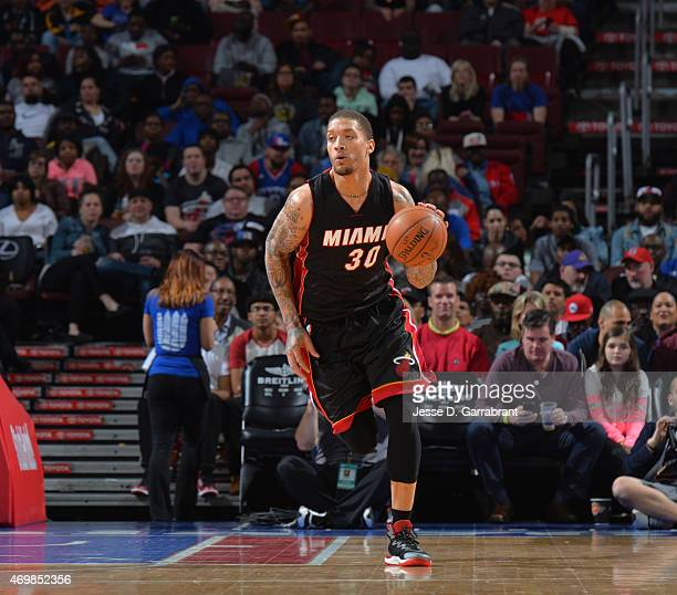 Michael Beasley of the Miami Heat dribbles up court against the Philadelphia 76ers at Wells Fargo Center on April 15 2015 in Philadelphia...