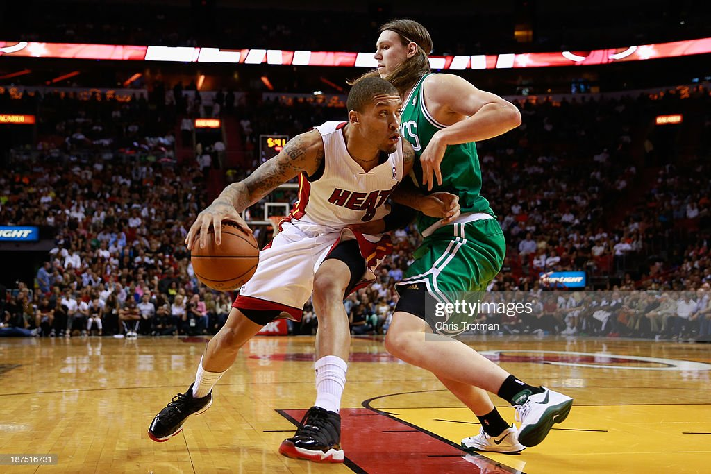 Michael Beasley #8 of the Miami Heat drives against Kelly Olynyk #41 of the Boston Celtics at American Airlines Arena on November 9, 2013 in Miami, Florida.