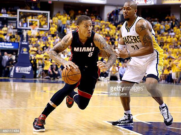 Michael Beasley of the Miami Heat drives to the basket against David West of the Indiana Pacers during Game Five of the Eastern Conference Finals of...