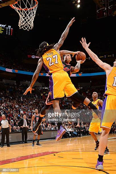 Michael Beasley of the Miami Heat drives to the basket against the Los Angeles Lakers at the American Airlines Arena in Miami Florida on January 23...