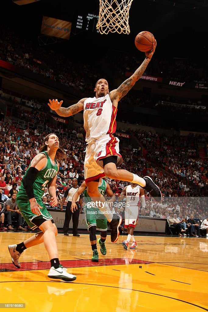 Michael Beasley #8 of the Miami Heat dunks against the Boston Celtics on November 9, 2013 at American Airlines Arena in Miami, Florida.