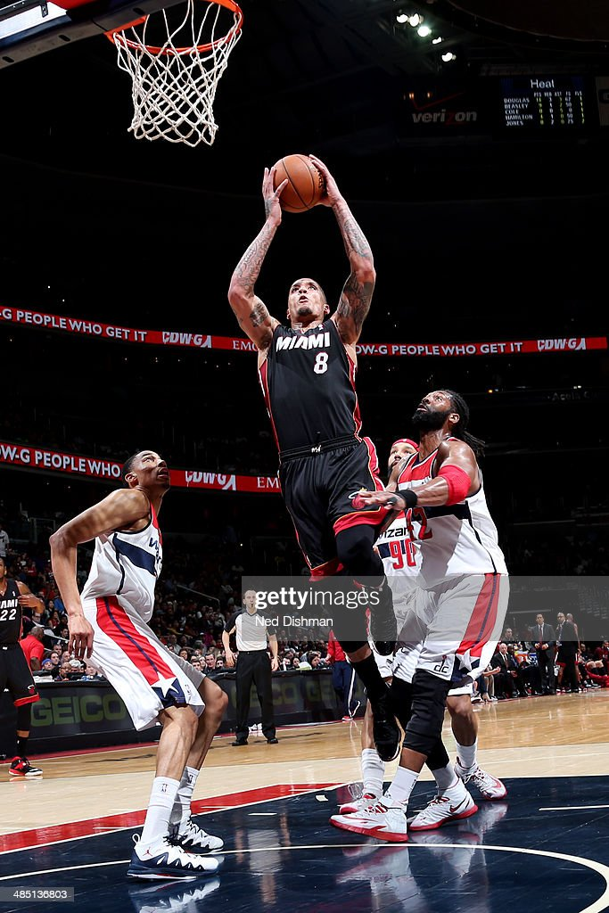 <a gi-track='captionPersonalityLinkClicked' href=/galleries/search?phrase=Michael+Beasley&family=editorial&specificpeople=4135134 ng-click='$event.stopPropagation()'>Michael Beasley</a> #8 of the Miami Heat dunks against the Washington Wizards at the Verizon Center on April 14, 2014 in Washington, DC.