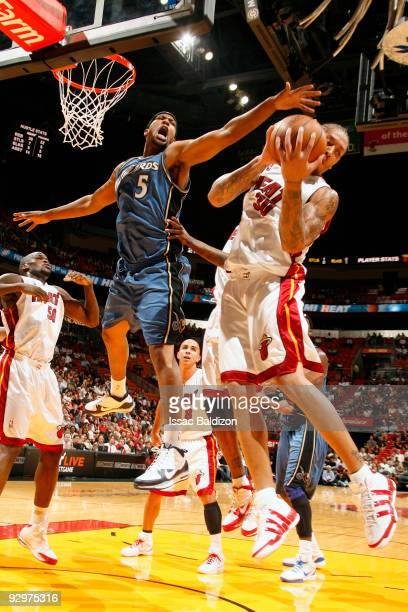 Michael Beasley of the Miami Heat grabs a rebound against Dominic McGuire of the Washington Wizards on November 10 2009 at American Airlines Arena in...