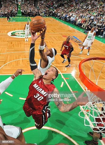 Michael Beasley of the Miami Heat rebounds against Paul Pierce of the Boston Celtics in Game Two of the Eastern Conference Quarterfinals during the...