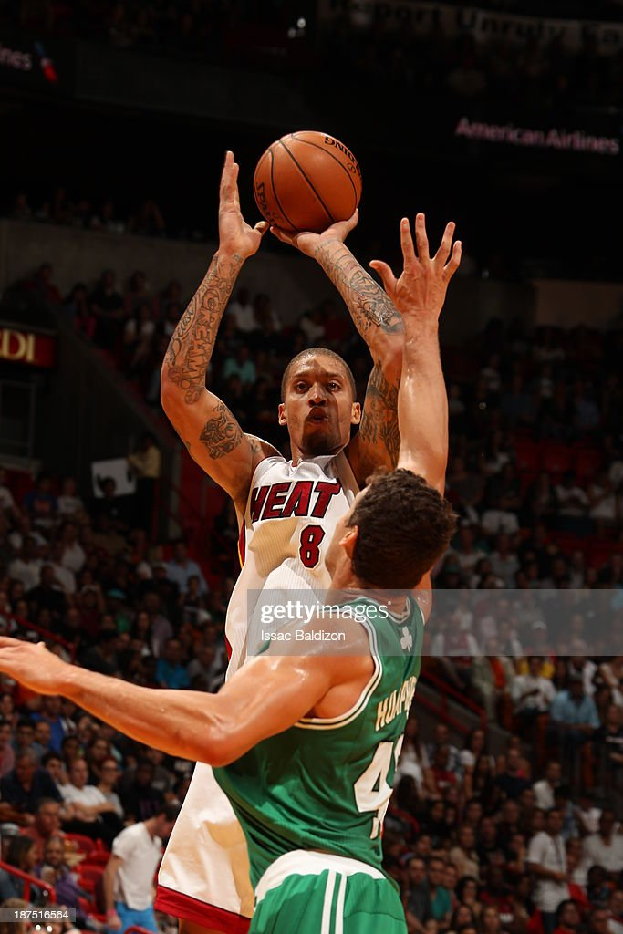 Michael Beasley #8 of the Miami Heat shoots against Kris Humphries #43 of the Boston Celtics on November 9, 2013 at American Airlines Arena in Miami, Florida.
