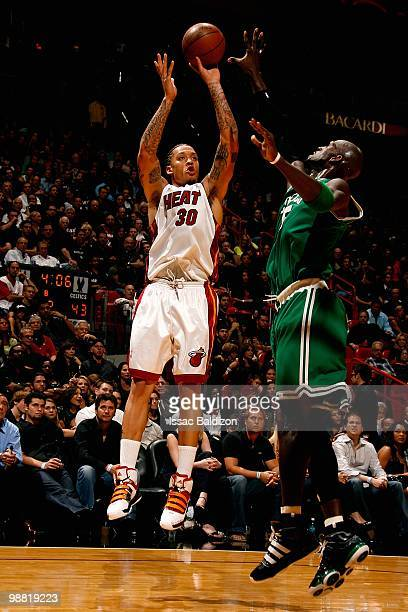 Michael Beasley of the Miami Heat shoots over Kevin Garnett of the Boston Celtics in Game Three of the Eastern Conference Quarterfinals during the...