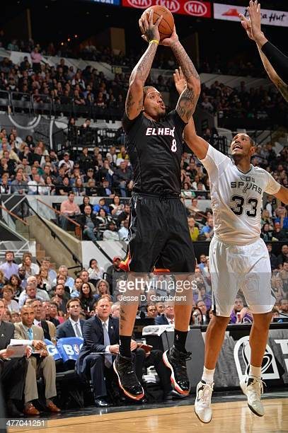 Michael Beasley of the Miami Heat takes a shot during a game against the San Antonio Spurs at the ATT Center March 6 2014 in San Antonio Texas NOTE...