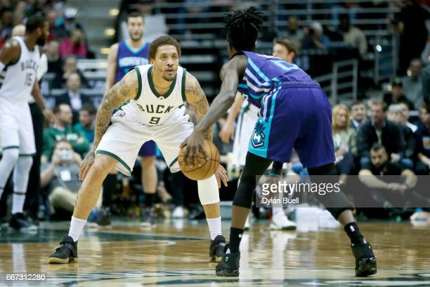 Michael Beasley of the Milwaukee Bucks guards against Briante Weber of the Charlotte Hornets in the second quarter at BMO Harris Bradley Center on...