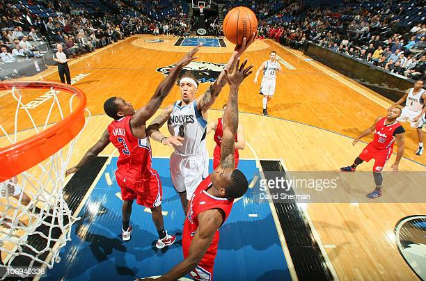 Michael Beasley of the Minnesota Timberwolves goes up for a basket against AlFarouq Aminu of the Los Angeles Clippers during the game on November 17...