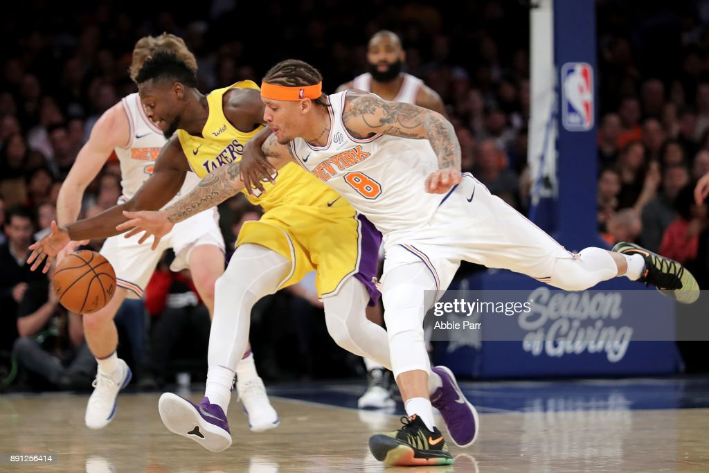 Michael Beasley #8 of the New York Knicks and Julius Randle #30 of the Los Angeles Lakers reach for the ball in the third quarter during their game at Madison Square Garden on December 12, 2017 in New York City.