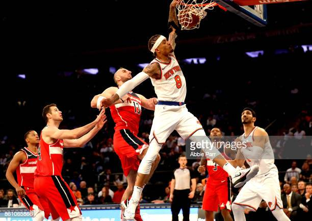 Michael Beasley of the New York Knicks dunks the ball during the second half against the Washington Wizards during their Pre Season game at Madison...