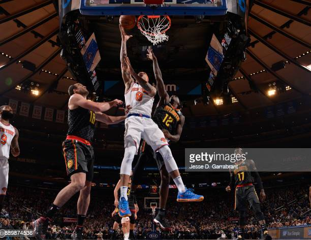 Michael Beasley of the New York Knicks goes up for the layup against the Atlanta Hawks at Madison Square Garden on December 10 2017 in New York New...
