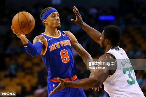 Michael Beasley of the New York Knicks looks for a pass with pressure from Semi Ojeleye of the Boston Celtics during the fourth quarter at TD Garden...