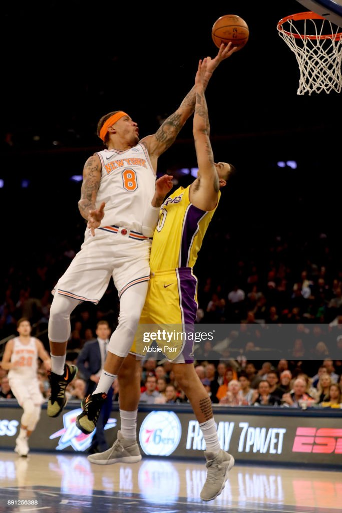 Michael Beasley #8 of the New York Knicks takes a shot against Julius Randle #30 of the Los Angeles Lakers in the fourth quarter during their game at Madison Square Garden on December 12, 2017 in New York City.