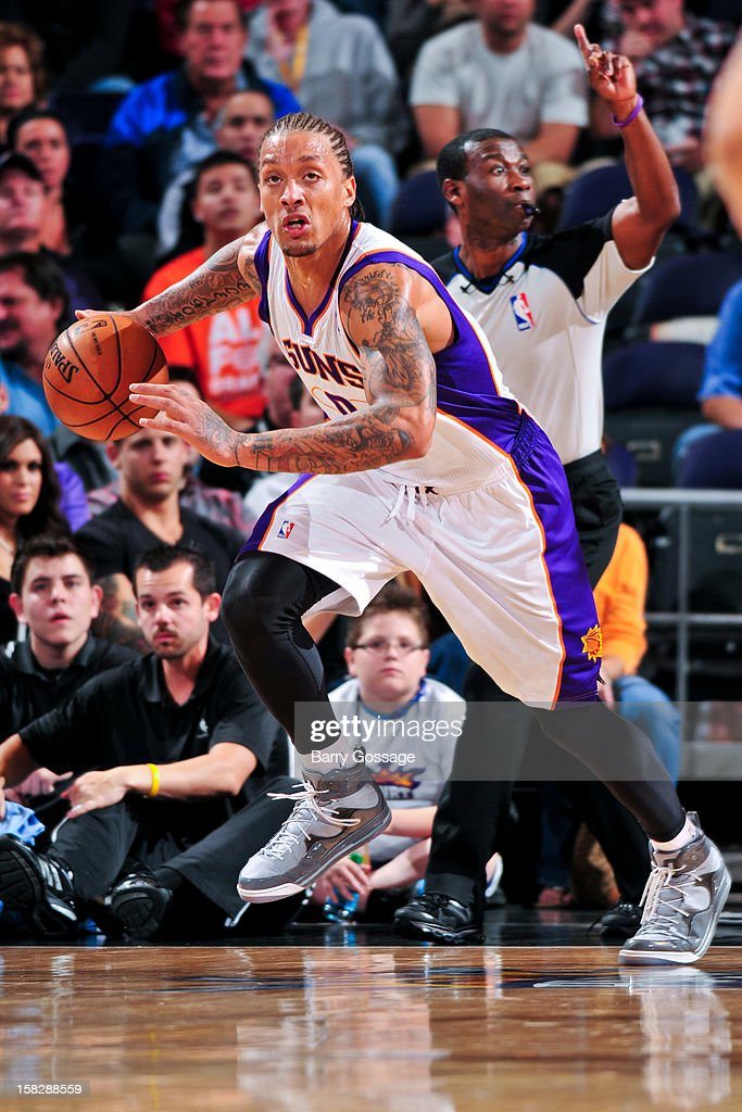 Michael Beasley #0 of the Phoenix Suns brings the ball upcourt against the Memphis Grizzlies on December 12, 2012 at U.S. Airways Center in Phoenix, Arizona.