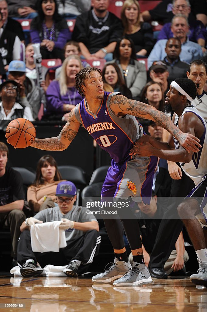 <a gi-track='captionPersonalityLinkClicked' href=/galleries/search?phrase=Michael+Beasley&family=editorial&specificpeople=4135134 ng-click='$event.stopPropagation()'>Michael Beasley</a> #0 of the Phoenix Suns controls the ball against <a gi-track='captionPersonalityLinkClicked' href=/galleries/search?phrase=John+Salmons&family=editorial&specificpeople=202524 ng-click='$event.stopPropagation()'>John Salmons</a> #5 of the Sacramento Kings on January 23, 2013 at Sleep Train Arena in Sacramento, California.