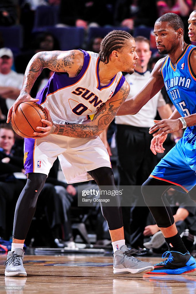 Michael Beasley #0 of the Phoenix Suns controls the ball against Kevin Durant #35 of the Oklahoma City Thunder on January 14, 2013 at U.S. Airways Center in Phoenix, Arizona.