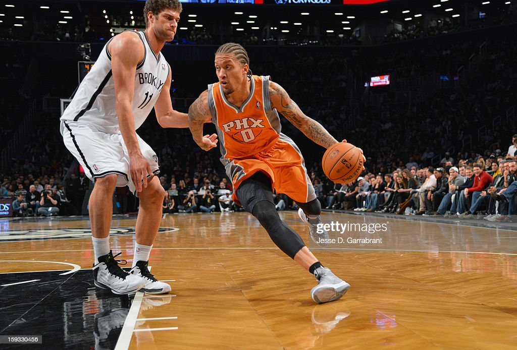 Michael Beasley #0 of the Phoenix Suns dribbles against Brook Lopez #11 of the Brooklyn Nets during the game at the Barclays Center on January 11, 2013 in Brooklyn, New York.