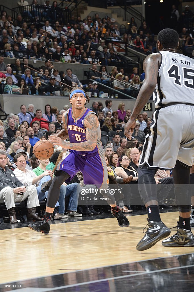 Michael Beasley #0 of the Phoenix Suns drives against DeJuan Blair #45 of the San Antonio Spurs on January 26, 2013 at the AT&T Center in San Antonio, Texas.