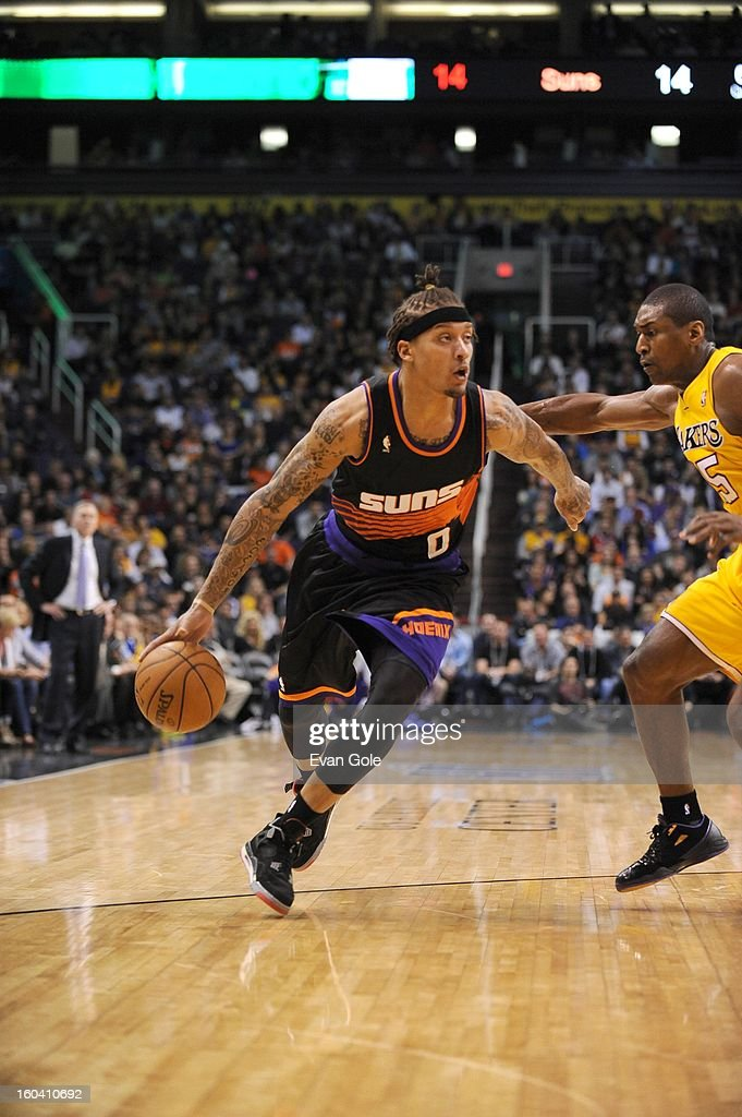 Michael Beasley #0 of the Phoenix Suns drives during the game between the Los Angeles Lakers and the Phoenix Suns at US Airways Center on January 30, 2013 in Phoenix, Arizona.