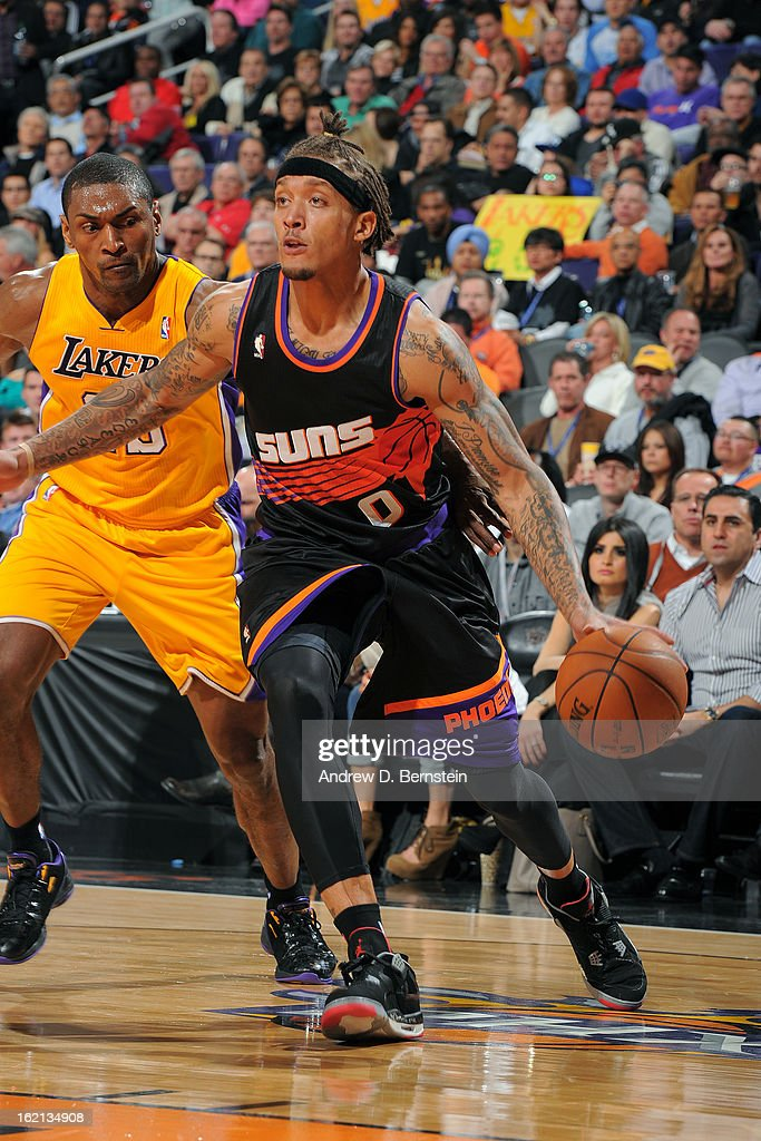 Michael Beasley #0 of the Phoenix Suns drives to the basket against the Los Angeles Lakers at US Airways Center on January 30, 2013 in Phoenix, Arizona.