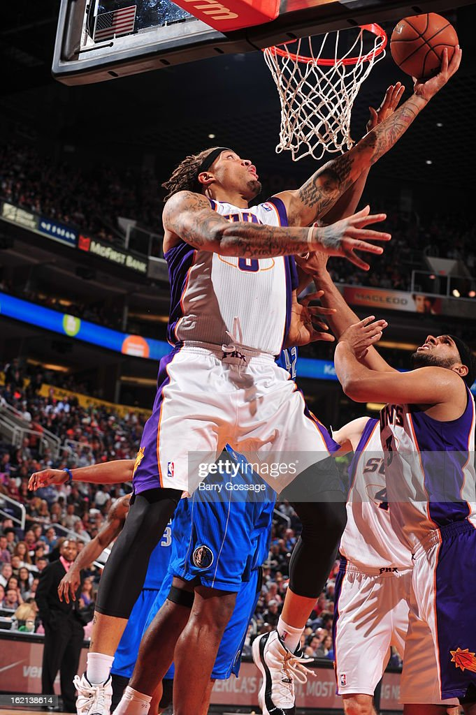 <a gi-track='captionPersonalityLinkClicked' href=/galleries/search?phrase=Michael+Beasley&family=editorial&specificpeople=4135134 ng-click='$event.stopPropagation()'>Michael Beasley</a> #0 of the Phoenix Suns drives to the basket against the Dallas Mavericks on February 1, 2013 at U.S. Airways Center in Phoenix, Arizona.