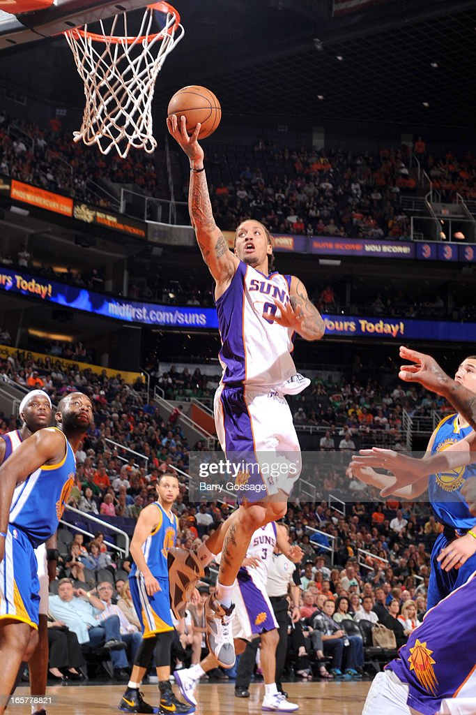 <a gi-track='captionPersonalityLinkClicked' href=/galleries/search?phrase=Michael+Beasley&family=editorial&specificpeople=4135134 ng-click='$event.stopPropagation()'>Michael Beasley</a> #0 of the Phoenix Suns drives to the basket against the Golden State Warriors on April 5, 2013 at U.S. Airways Center in Phoenix, Arizona.