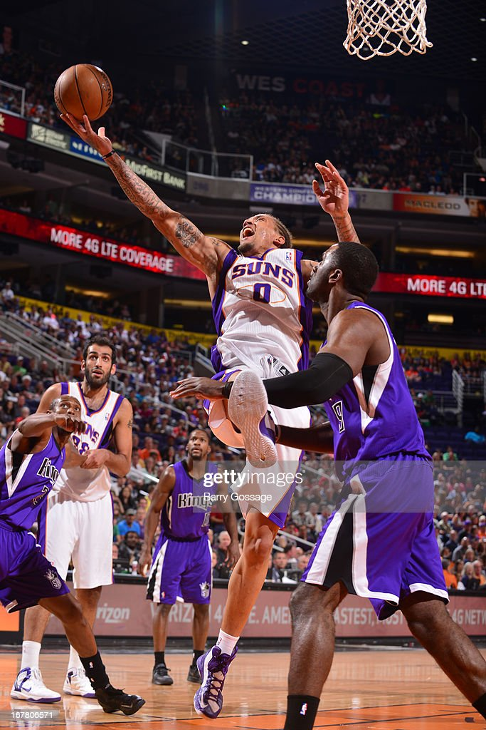 <a gi-track='captionPersonalityLinkClicked' href=/galleries/search?phrase=Michael+Beasley&family=editorial&specificpeople=4135134 ng-click='$event.stopPropagation()'>Michael Beasley</a> #0 of the Phoenix Suns drives to the basket against the Sacramento Kings on March 28, 2013 at U.S. Airways Center in Phoenix, Arizona.