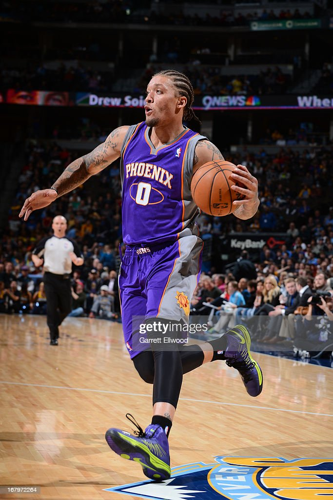 <a gi-track='captionPersonalityLinkClicked' href=/galleries/search?phrase=Michael+Beasley&family=editorial&specificpeople=4135134 ng-click='$event.stopPropagation()'>Michael Beasley</a> #0 of the Phoenix Suns drives to the basket against the Denver Nuggets on April 17, 2013 at the Pepsi Center in Denver, Colorado.