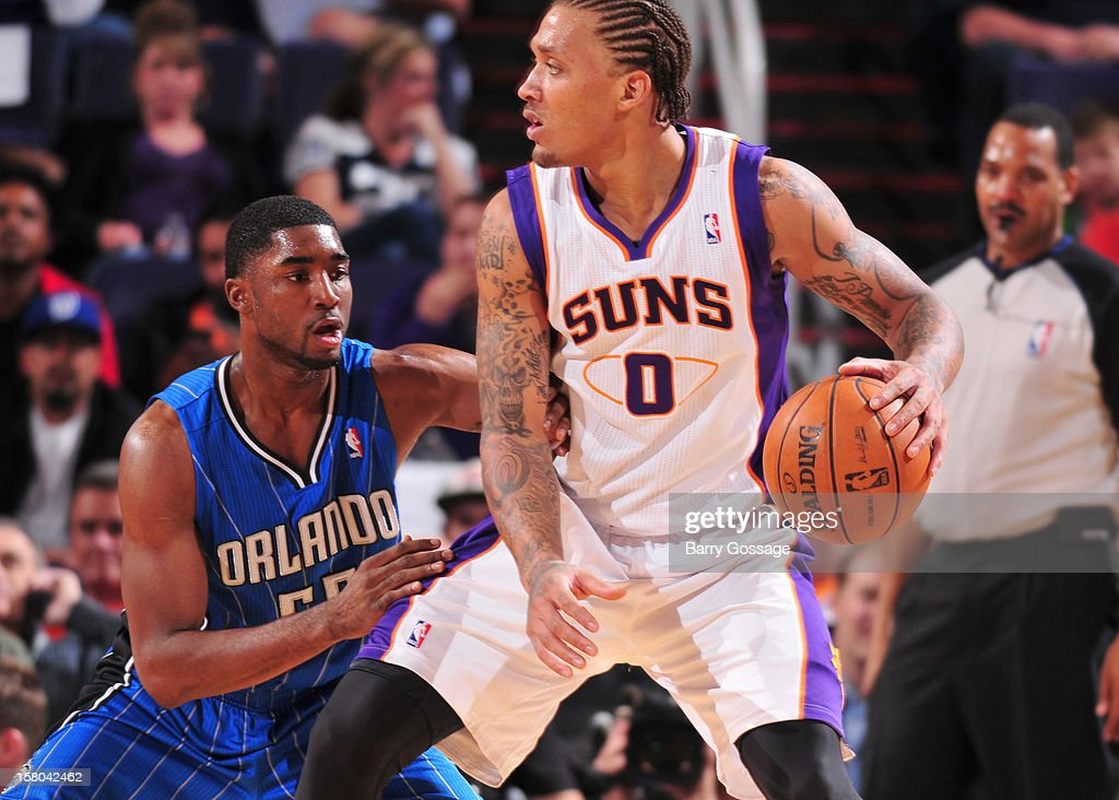 Michael Beasley #0 of the Phoenix Suns is guarded by E'Twaun Moore #55 of the Orlando Magic on December 9, 2012 at U.S. Airways Center in Phoenix, Arizona.