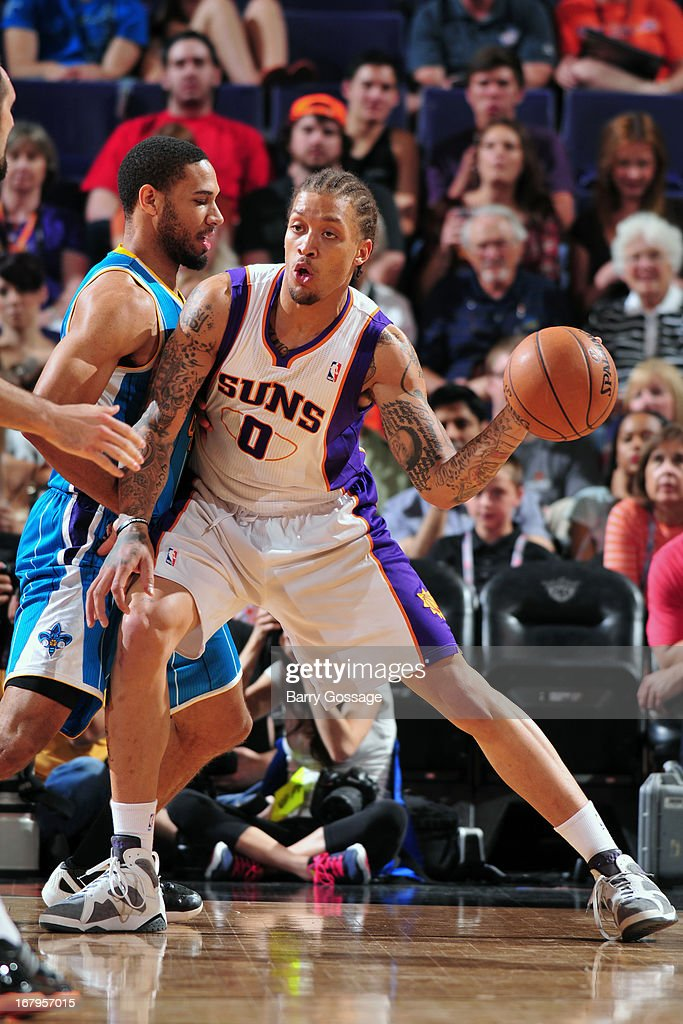 <a gi-track='captionPersonalityLinkClicked' href=/galleries/search?phrase=Michael+Beasley&family=editorial&specificpeople=4135134 ng-click='$event.stopPropagation()'>Michael Beasley</a> #0 of the Phoenix Suns looks to pass the ball against the New Orleans Hornets on April 7, 2013 at U.S. Airways Center in Phoenix, Arizona.