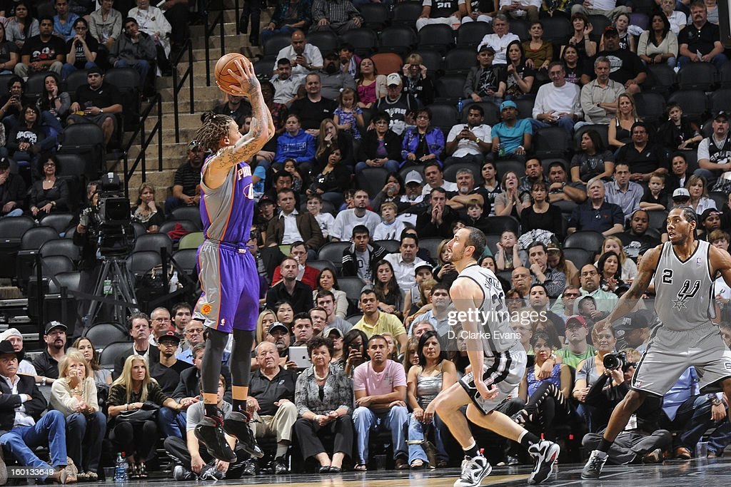 Michael Beasley #0 of the Phoenix Suns shoots a jumper against Manu Ginobili #20 of the San Antonio Spurs on January 26, 2013 at the AT&T Center in San Antonio, Texas.