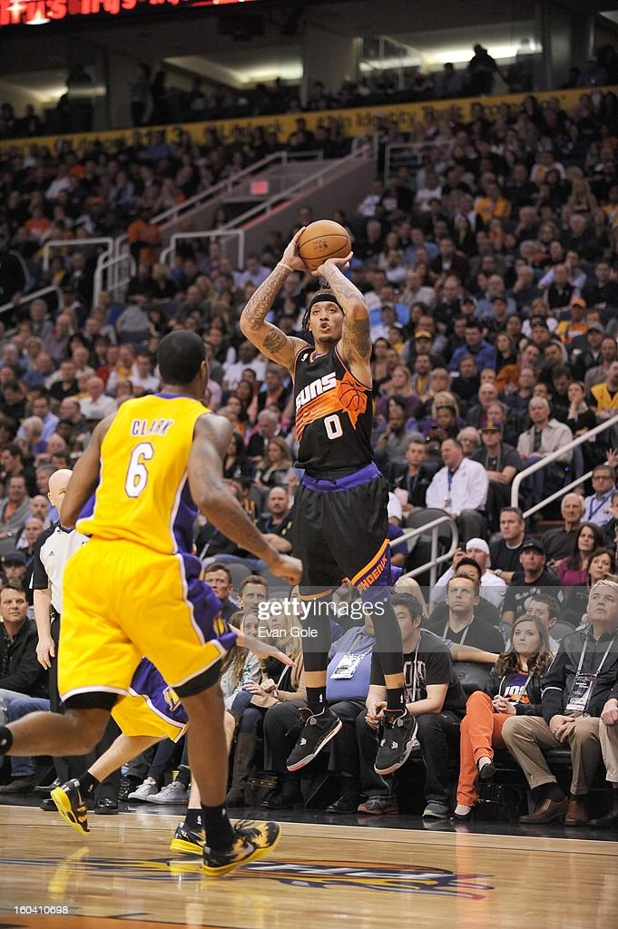 Michael Beasley #0 of the Phoenix Suns shoots a jumper during the game between the Los Angeles Lakers and the Phoenix Suns at US Airways Center on January 30, 2013 in Phoenix, Arizona.