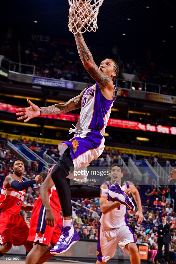 Michael Beasley #0 of the Phoenix Suns shoots a layup against the Washington Wizards on March 20, 2013 at U.S. Airways Center in Phoenix, Arizona.