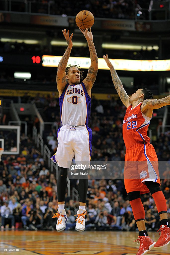 <a gi-track='captionPersonalityLinkClicked' href=/galleries/search?phrase=Michael+Beasley&family=editorial&specificpeople=4135134 ng-click='$event.stopPropagation()'>Michael Beasley</a> #0 of the Phoenix Suns shoots against <a gi-track='captionPersonalityLinkClicked' href=/galleries/search?phrase=Matt+Barnes+-+Basketball+Player&family=editorial&specificpeople=202880 ng-click='$event.stopPropagation()'>Matt Barnes</a> #22 of the Los Angeles Clippers at US Airways Center on January 24, 2013 in Phoenix, Arizona.