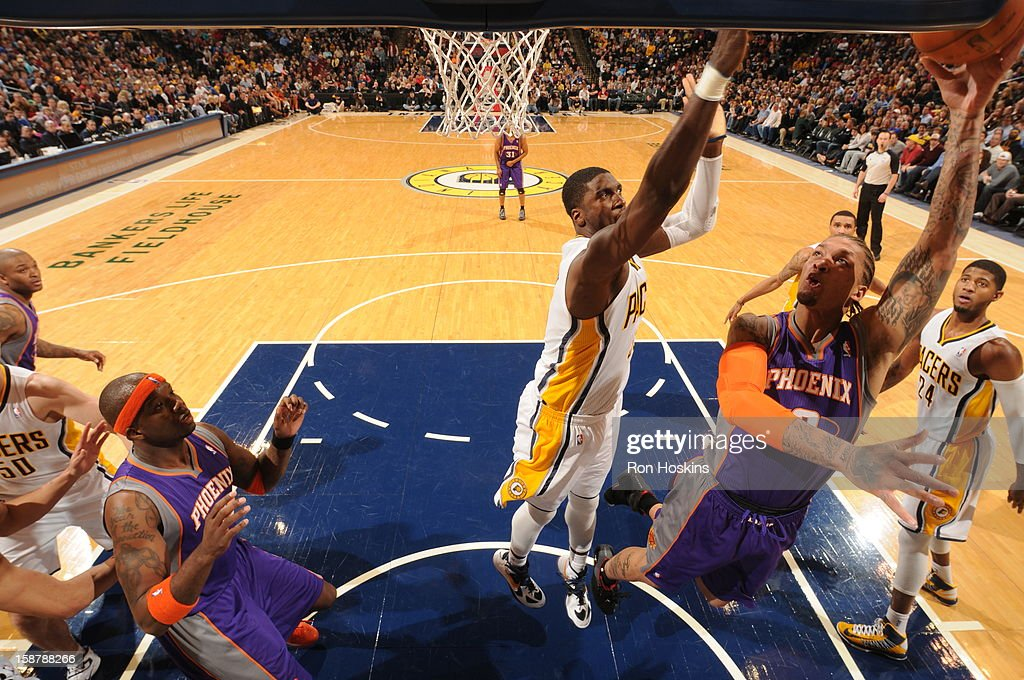 <a gi-track='captionPersonalityLinkClicked' href=/galleries/search?phrase=Michael+Beasley&family=editorial&specificpeople=4135134 ng-click='$event.stopPropagation()'>Michael Beasley</a> #0 of the Phoenix Suns shoots against <a gi-track='captionPersonalityLinkClicked' href=/galleries/search?phrase=Roy+Hibbert&family=editorial&specificpeople=725128 ng-click='$event.stopPropagation()'>Roy Hibbert</a> #55 of the Indiana Pacers on December 28, 2012 at Bankers Life Fieldhouse in Indianapolis, Indiana.