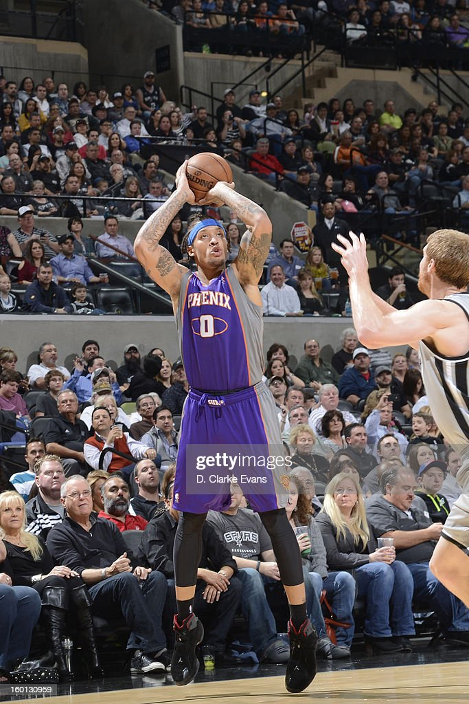 Michael Beasley #0 of the Phoenix Suns shoots against the San Antonio Spurs on January 26, 2013 at the AT&T Center in San Antonio, Texas.