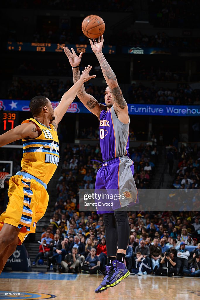 <a gi-track='captionPersonalityLinkClicked' href=/galleries/search?phrase=Michael+Beasley&family=editorial&specificpeople=4135134 ng-click='$event.stopPropagation()'>Michael Beasley</a> #0 of the Phoenix Suns shoots the ball against the Denver Nuggets on April 17, 2013 at the Pepsi Center in Denver, Colorado.