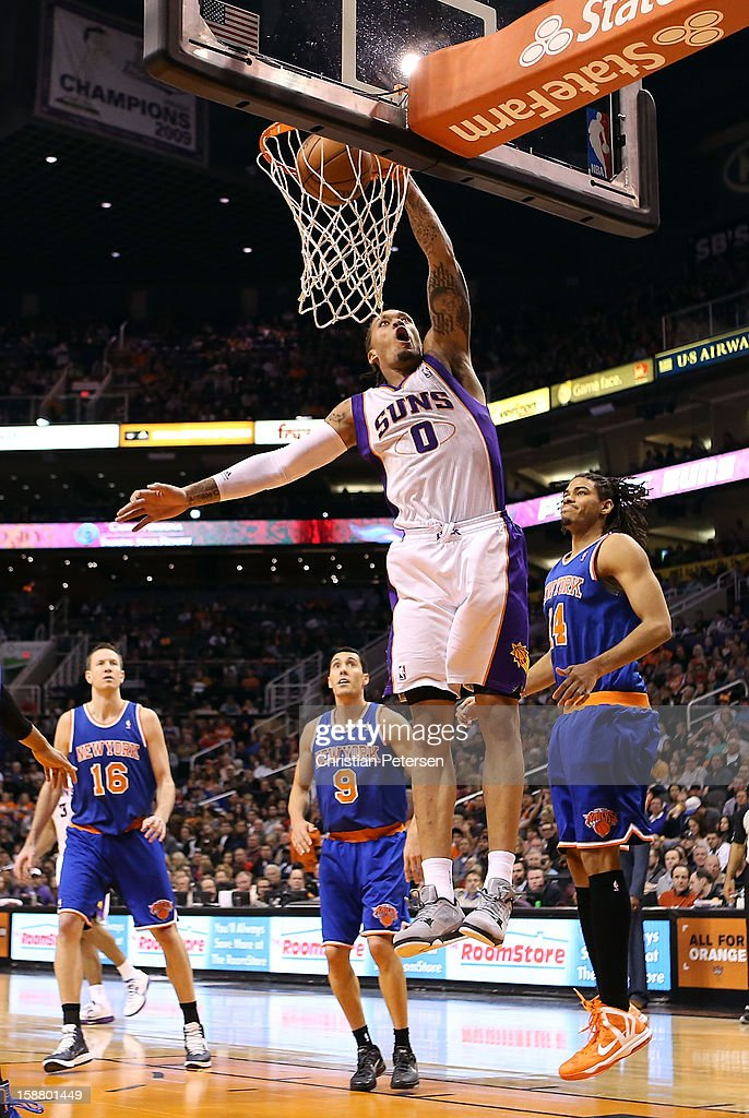 <a gi-track='captionPersonalityLinkClicked' href=/galleries/search?phrase=Michael+Beasley&family=editorial&specificpeople=4135134 ng-click='$event.stopPropagation()'>Michael Beasley</a> #0 of the Phoenix Suns slam dunks the ball against the New York Knicks during the NBA game at US Airways Center on December 26, 2012 in Phoenix, Arizona. The Knicks defeated the Suns 99-97.