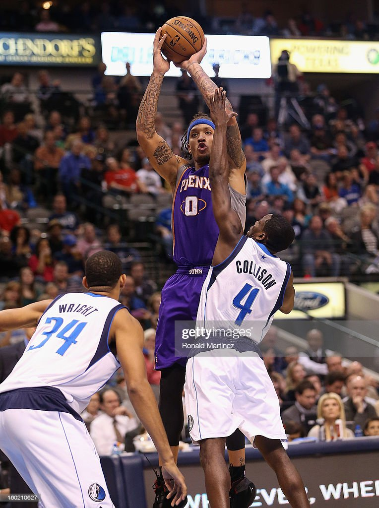 Michael Beasley #0 of the Phoenix Suns takes a shot against Darren Collison #4 of the Dallas Mavericks at American Airlines Center on January 27, 2013 in Dallas, Texas.