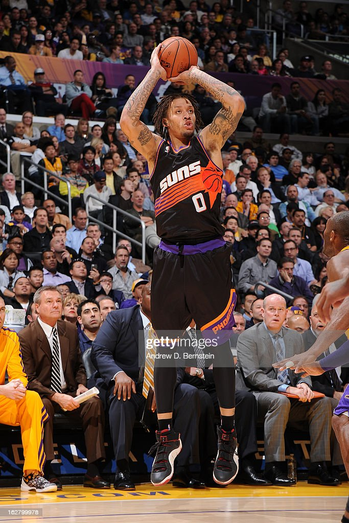 <a gi-track='captionPersonalityLinkClicked' href=/galleries/search?phrase=Michael+Beasley&family=editorial&specificpeople=4135134 ng-click='$event.stopPropagation()'>Michael Beasley</a> #0 of the Phoenix Suns takes a shot against the Los Angeles Lakers at Staples Center on February 12, 2013 in Los Angeles, California.