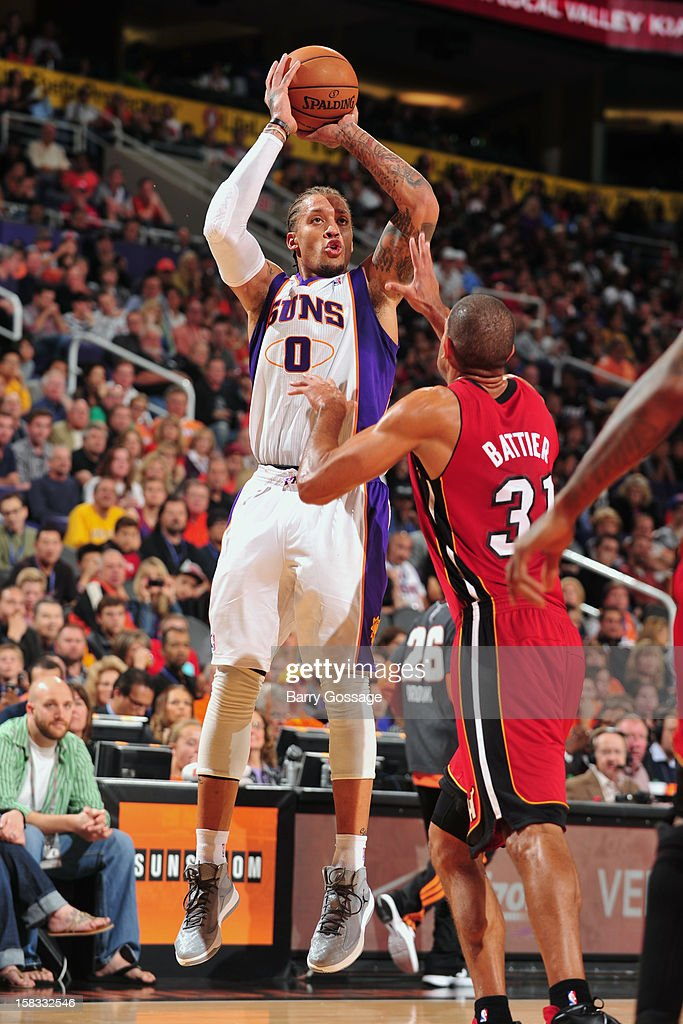 <a gi-track='captionPersonalityLinkClicked' href=/galleries/search?phrase=Michael+Beasley&family=editorial&specificpeople=4135134 ng-click='$event.stopPropagation()'>Michael Beasley</a> #0 of the Phoenix Suns takes a shot over <a gi-track='captionPersonalityLinkClicked' href=/galleries/search?phrase=Shane+Battier&family=editorial&specificpeople=201814 ng-click='$event.stopPropagation()'>Shane Battier</a> #31 of the Miami Heat on November 17, 2012 at U.S. Airways Center in Phoenix, Arizona.