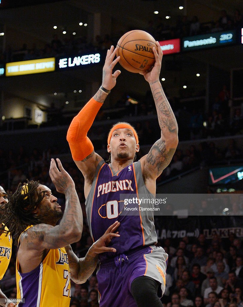 Michael Beasley#0 of the Phoenix Suns goes up for a layup against Jordan Hill #27 of the Los Angeles Lakers at Staples Center on November 16, 2012 in Los Angeles, California.