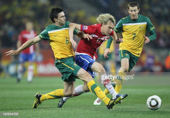 Michael Beauchamp of Australia and Milos Krasic of Serbia battle for the ball during the 2010 FIFA World Cup South Africa Group D match between...